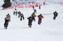 Snow bikers on race Royalty Free Stock Image