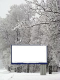 Snow billboard. Billboard covered with snow on the background of the park stock photo