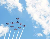 Snow Bird 1. Canadian Forces 431 Air Demonstration Squadron - the Snow Birds flying in formation against a blue cloudy sky Royalty Free Stock Photo