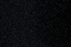 Snow on a black background Stock Images