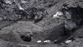 Snow and black earth from Etna in Sicily royalty free stock photo