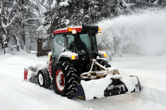 Snow Blower. At work after heavy snowfall stock images