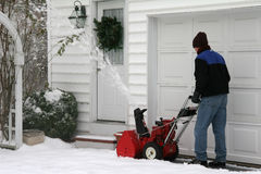 Snow Blower. Man using a snow blower to clear out a driveway stock photo
