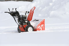 Snow blower. In the snow clearing out a path royalty free stock photos