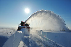 Snow blower cleaning. Snowplow  removing snow for cleaning road Stock Photography