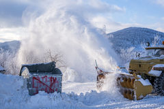 Snow blower cleaning the road Royalty Free Stock Photo