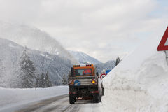 Snowplough clears a road from snow Stock Photo