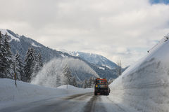 Snow blower clears  road from snow Royalty Free Stock Image