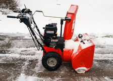 Snow blower on drive way with freshly fallen snow Stock Photography
