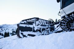 Snow blower machine. Snow grooming machine ratrak on ski slopes in a winter resort stock images