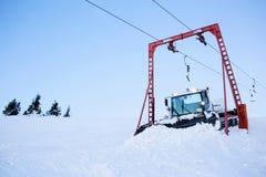 Snow blower machine. Snow grooming machine ratrak on ski slopes in a winter resort royalty free stock photo