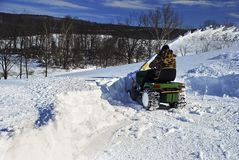 Snow Blower man clearing driveway Stock Photo