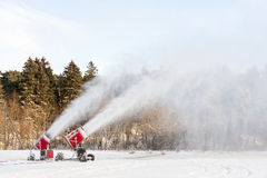 Snow blowing machines. Or snow cannons making snow Royalty Free Stock Image