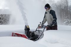 Snow blowing man Royalty Free Stock Photo