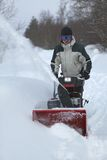 Snow blowing man Stock Photography