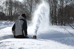 Snow blowing man Stock Image