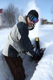 Snow blowing man Royalty Free Stock Images