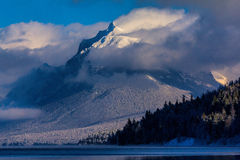 Snow Blowing Off The Rugged Mountain Stock Photography