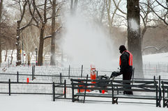 Snow blowing in the park Stock Image