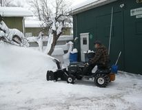 Snow blowing on tractor Stock Images