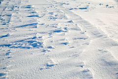 Snow blown by the wind. Snow tracks producing a snow background Stock Photos