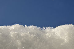 Snow and blue sky Royalty Free Stock Photos
