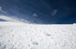 Snow and blue sky Stock Images