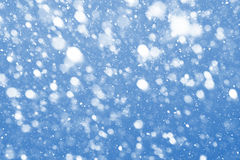 Snow in blue sky Stock Image