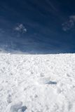 Snow and blue sky with clouds Royalty Free Stock Photos