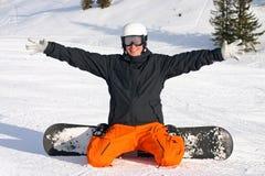 Snow board fun. Young man having fun in the snow with his board Stock Image