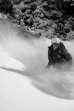 Snow boarder #1 in action. Snowboarder enjoys fresh powder at snowbird ski and summer resort Stock Image