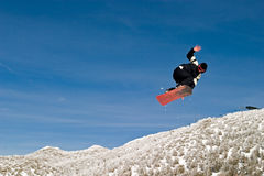 Snow Boarder in the Air Stock Photo