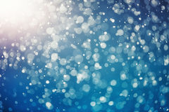 Snow bokeh texture on blue Royalty Free Stock Images