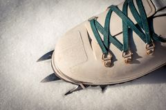 Snow boot with crampons. On snow stock photography