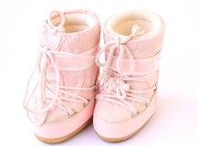 Snow boots. Kid's pair of snow boots also known as moon boots isolated on a white background Royalty Free Stock Images