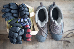 Snow boots and a bag of winter gloves and mittens Royalty Free Stock Image
