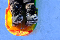 Snow Boots in Sled on Snow Winter Time Playing Royalty Free Stock Image