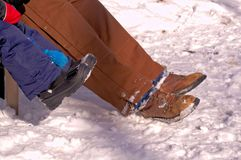 Snow boots in the snow Stock Images
