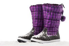 Snow boots on a white Royalty Free Stock Images