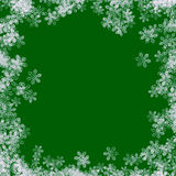 Snow Border 01. Snowflake border on a green background stock illustration