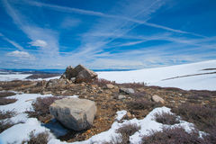 Snow and Boulders in California Mountains Stock Photo