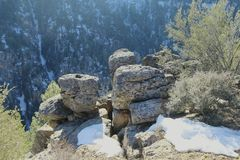Snow boulders and mountains Royalty Free Stock Image