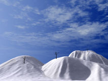 Snow-bound hills. Brightly-blue sky and asleep trees Royalty Free Stock Image