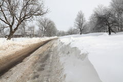 Snow-bound winter road Royalty Free Stock Image