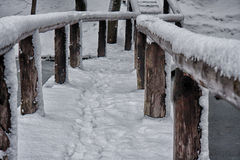 Snow on the bridge. The first snow filled up the small bridge Royalty Free Stock Photos