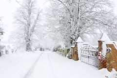 Snow on British country road in winter stock images