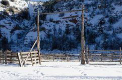 Snow in the broken down corral. Royalty Free Stock Photo