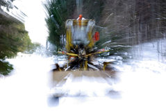 Snow buldoser coming Stock Images