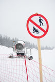 A snow cannon being used to cover a mountain Stock Images