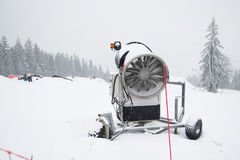 A snow cannon being used to cover a mountain Royalty Free Stock Image